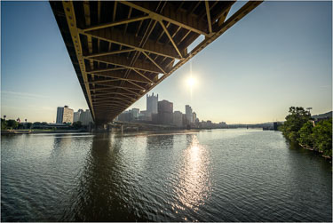 Watching-The-Sun-Climb-From-Under-The-Crossing.jpg