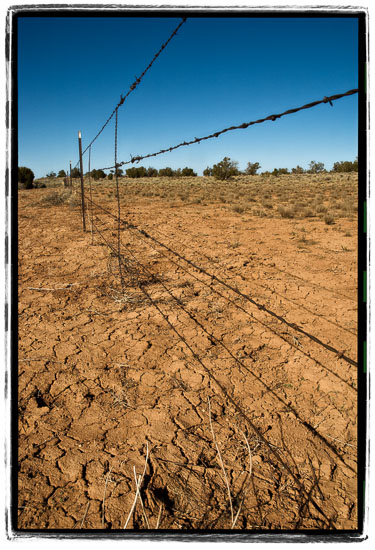 Cracked-Earth-And-Barbed-Wire-For-Miles.jpg